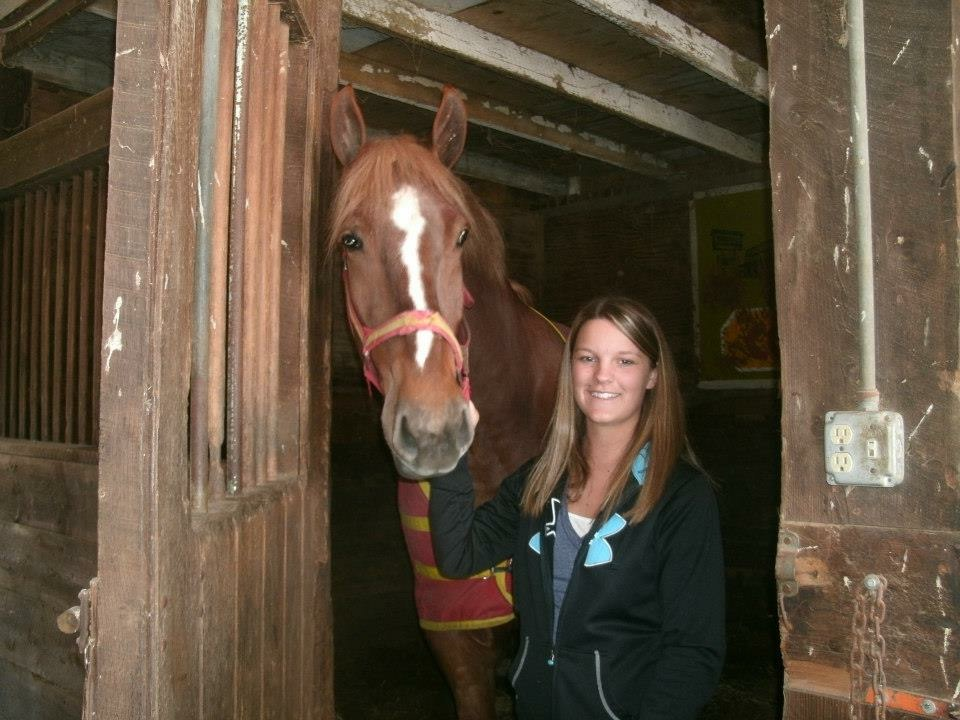 Team member Kaitlyn with her horse